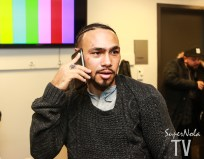 KEITH THURMAN TAKES CONGRATULATORY CALLS IN THE LOCKER-ROOM AFTER THE PRESS CONFERENCE