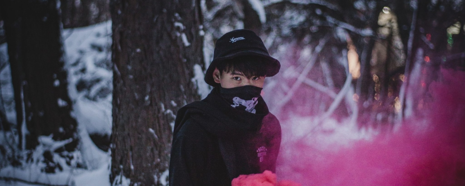 photo-of-man-surrounded-by-red-smoke-1034674
