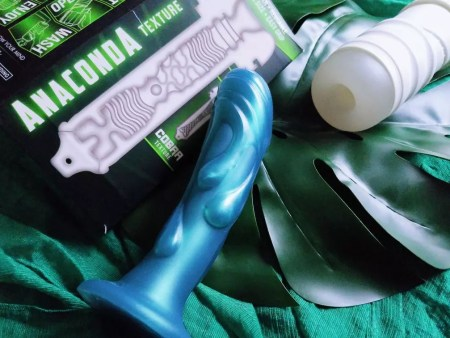 Picture of Zolo Twist Anaconda stroker/masturbation cup next to packaging and Tantus Splash