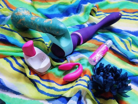 [Image: We-Vibe Wand with Stroker attachment around Uberrime Aqua-King. A pink We-Vibe Chorus is also in the foreground]