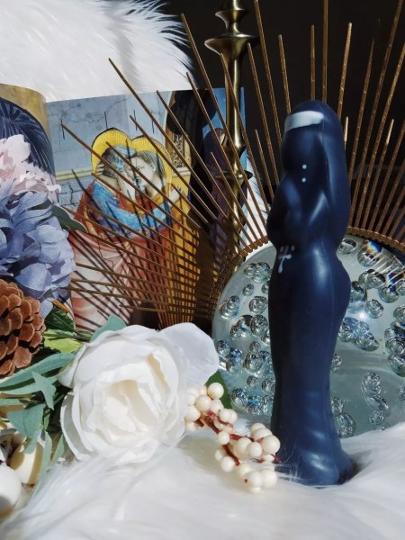 [Image: side view of the Hole Punch Mother Interior nun dildo in front of zip tie halo crown and Giotto painting in art book]