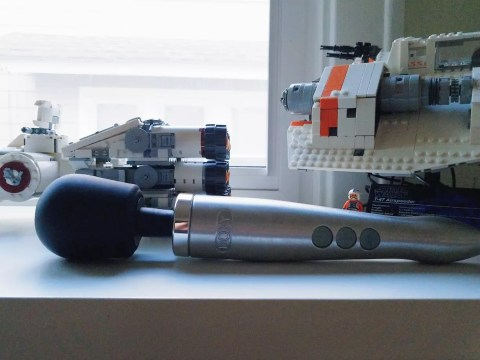 [Image: silver Doxy Die Cast aluminum and titanium vibrator side view with Star Wars Legos]