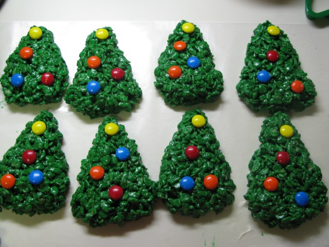here are some rice krispie treats that are colored and shaped like christmas trees to get in the holiday spirit
