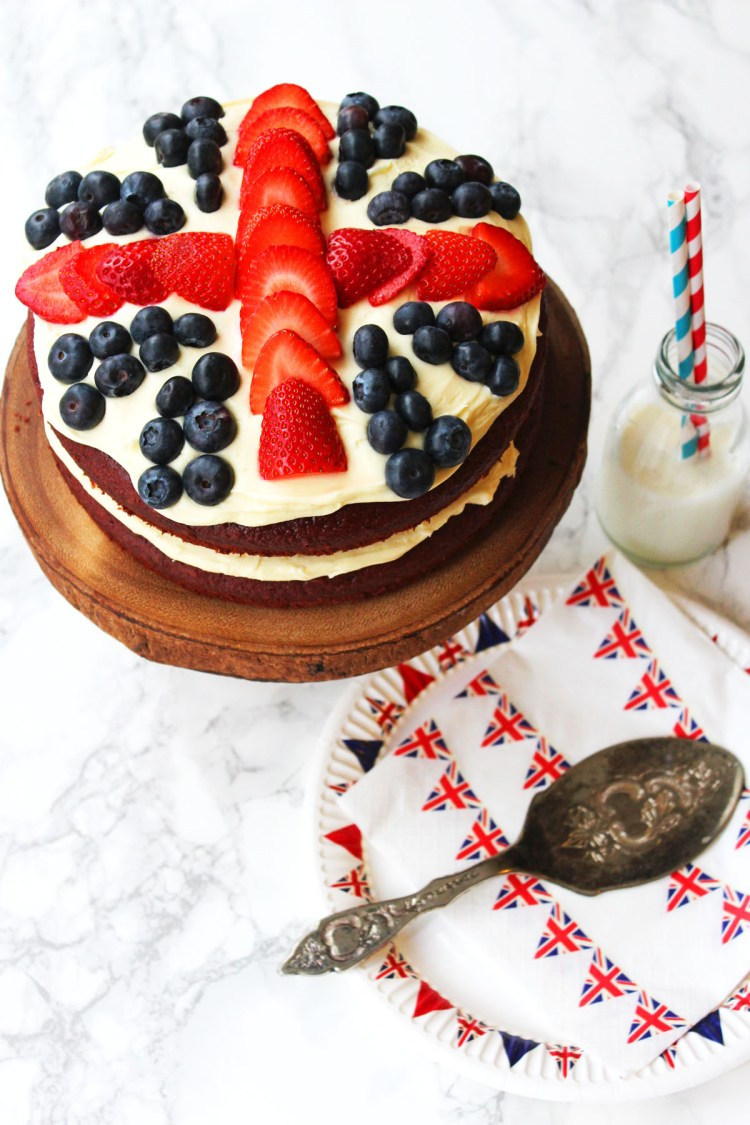 This Royal Red Velvet Layer Cake from Supper in the Suburbs is topped with Cream Cheese Forsting and Fresh Berries for a Union Jack Cake fit for a royal celebration.