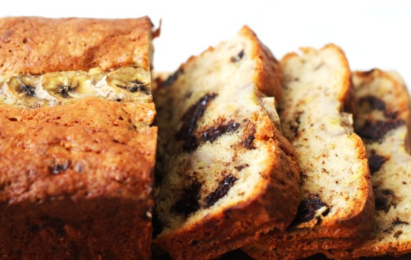 The Ultimate Chocolate Chip Banana Bread cut into thick slices.