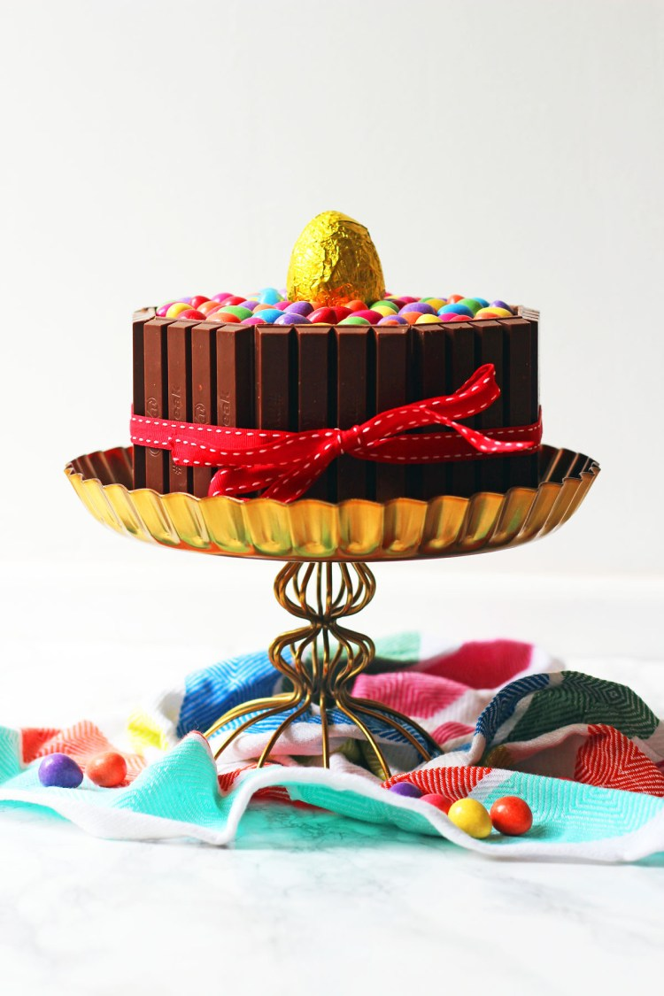 This over the top Chocolate Easter Cake is a real showstopped. Made with chocolate sponge, chocolate buttercream and covered in chocolate bars and candy it is a chocoholics dream. Get the recipe at Supper in the Suburbs!