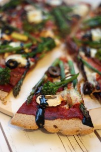A slice of Broccoli and Asparagus Pizza with Balsamic Glaze