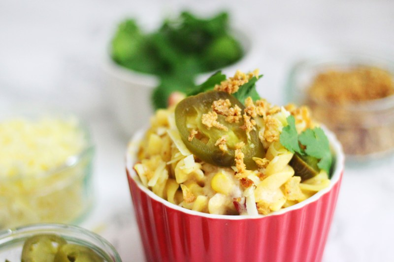 My Killer Mac and Cheese is topped with cheddar, jalapenos, coriander and crispy onions find the recipe at Supper in the Suburbs