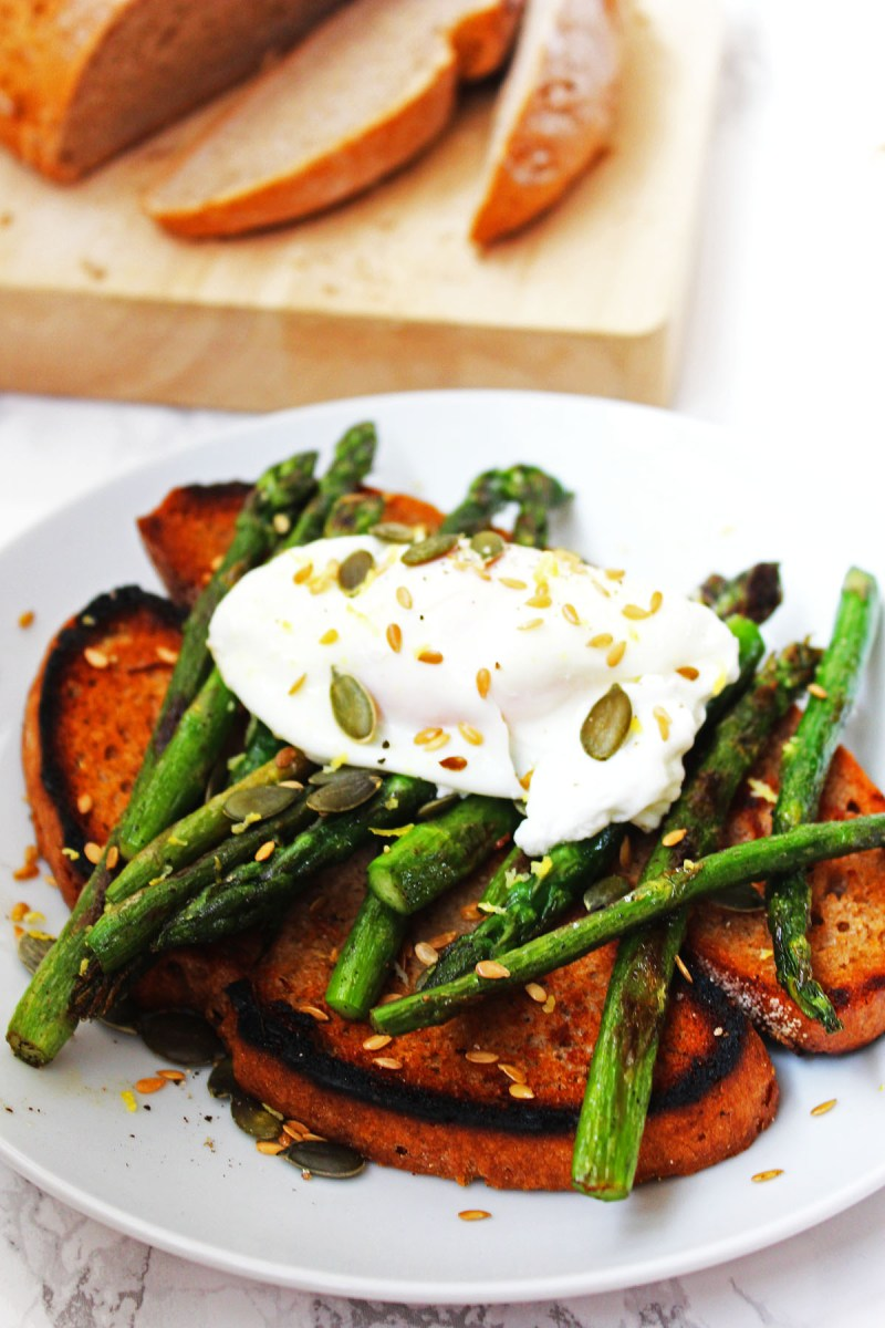 Lemon Griddled Asparagus and Poached Egg on Toast with Golden Linseed and Pumpkin Seeds