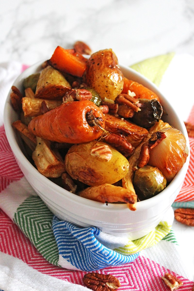 Maple roasted vegetables with pecan crunch are the perfect side dish for Thanksgiving, Christmas or your weekly roast dinner. Get the recipe for this simple on pot dish at Supper in the Suburbs!