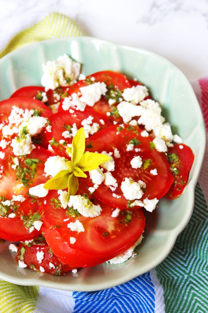 This delicious Tomato, Feta and Oregano Salad is inspired by holidays to Greece. Why not pack it for a picnic or serve it up at your next BBQ as a tasty side dish. Get the recipe at Supper in the Suburbs!