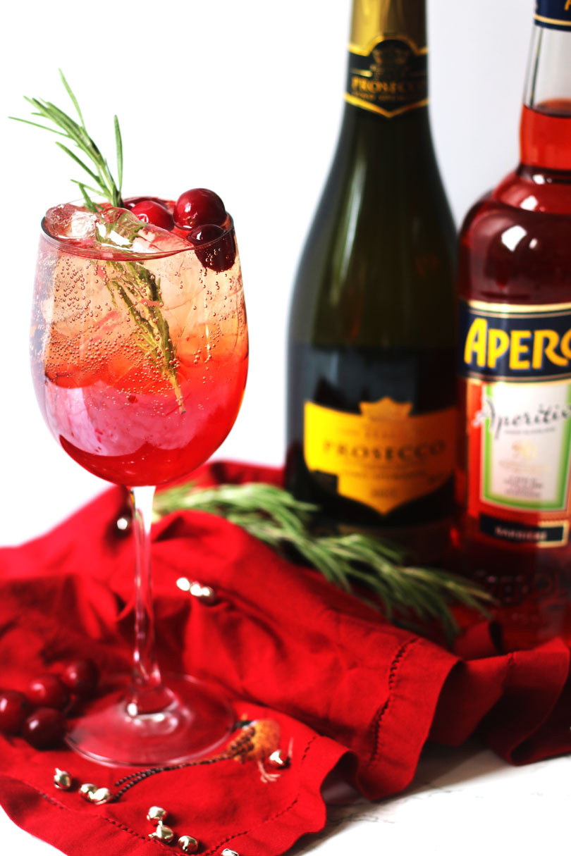 Cranberry and Aperol Sprtiz made with cranberry juice, aperol and prosecco.