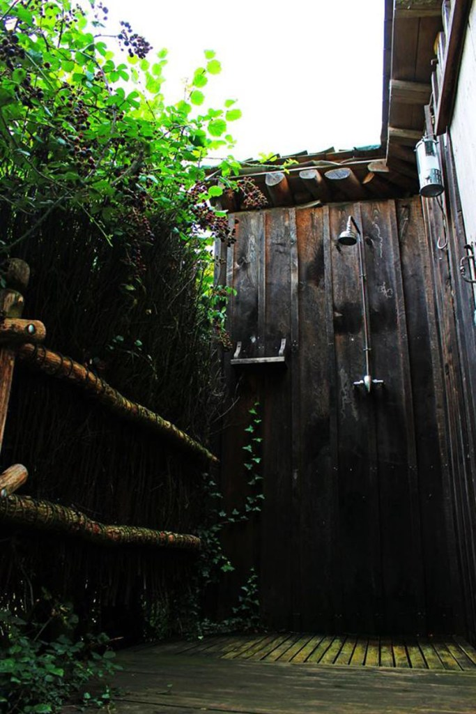 Showering outdoors is an experience not to miss while glamping off-grid