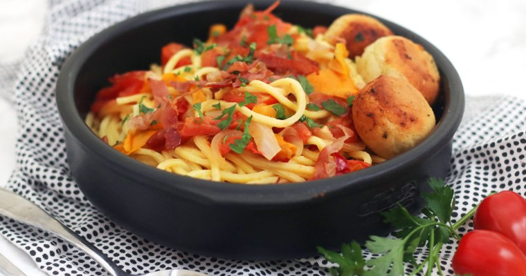 Crispy Parma Ham topped Spaghetti with roasted peppers and cherry tomatoes