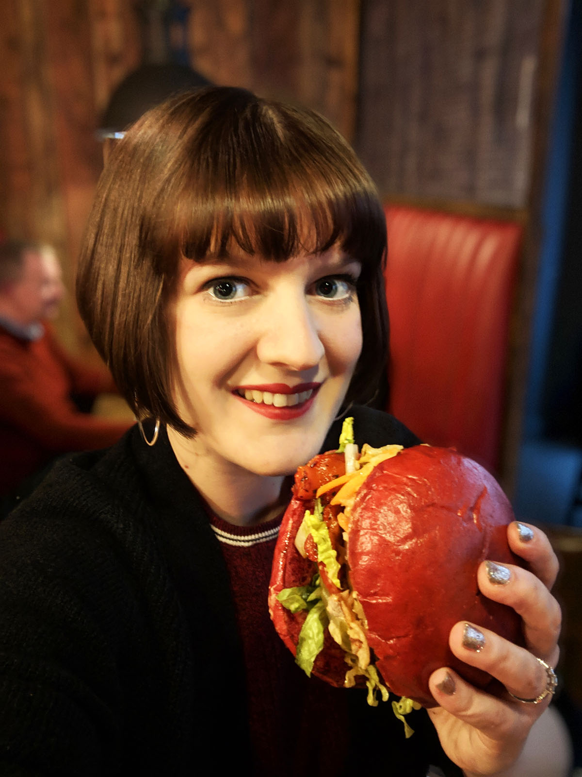 Eating a vegan burger