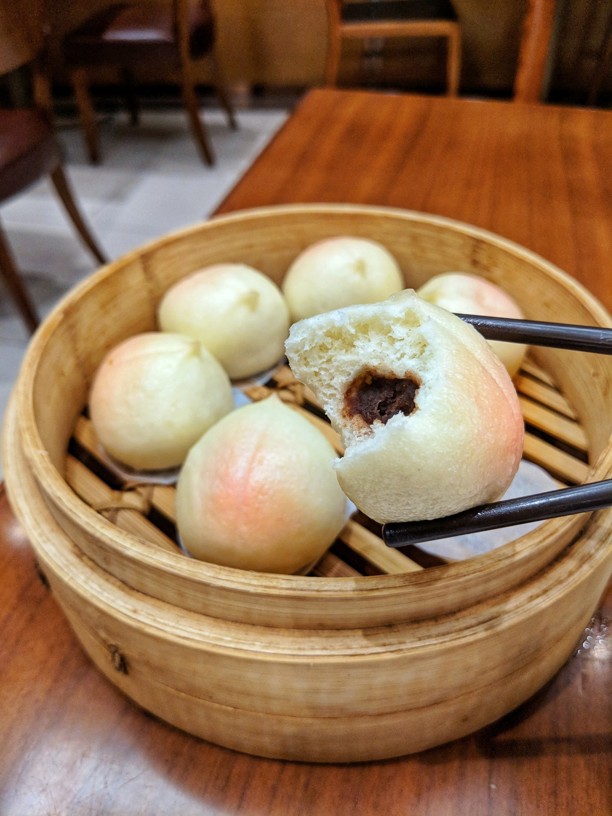 Steamed peach buns filled with red bean pasta from Din Tai Fung in Hong Kong