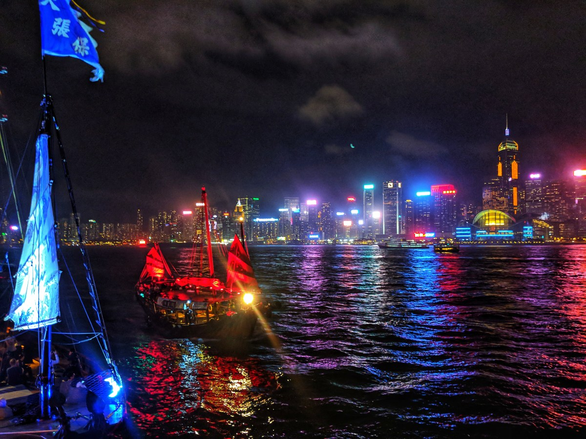 Traditional fishing boat in Victoria Bay, Hong Kong lit up at night