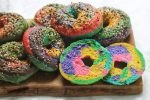 A pile of Rainbow Bagels sliced open