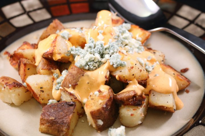 Buffalo Style Potatoes Plated with Crumbled Blue Cheese