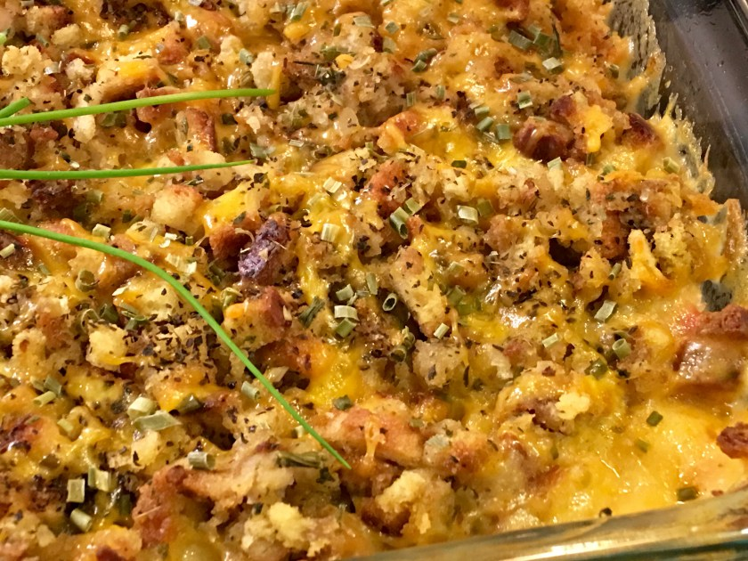 Chicken Cordon Bleu Casserole with Stuffing out of the oven close up of sauce