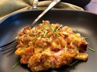Chicken Cordon Bleu Casserole with Stuffing Plated with Chives
