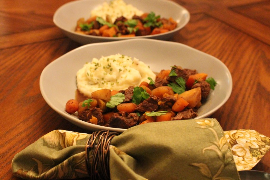 Two bowls of Beef Stew with Parsnips side by side with a green napkin