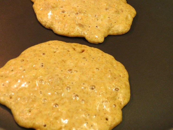 Apple Cinnamon Pancakes on the griddle