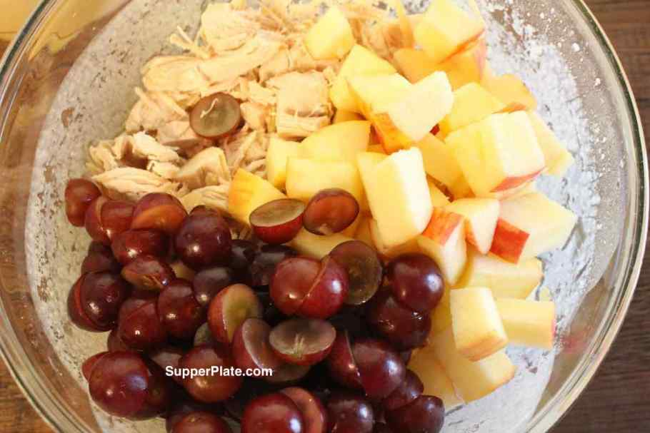 Chopped grapes and chopped apples on a plate