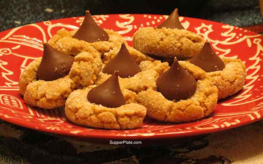 Peanut Butter Blossoms on a red Christmas plate