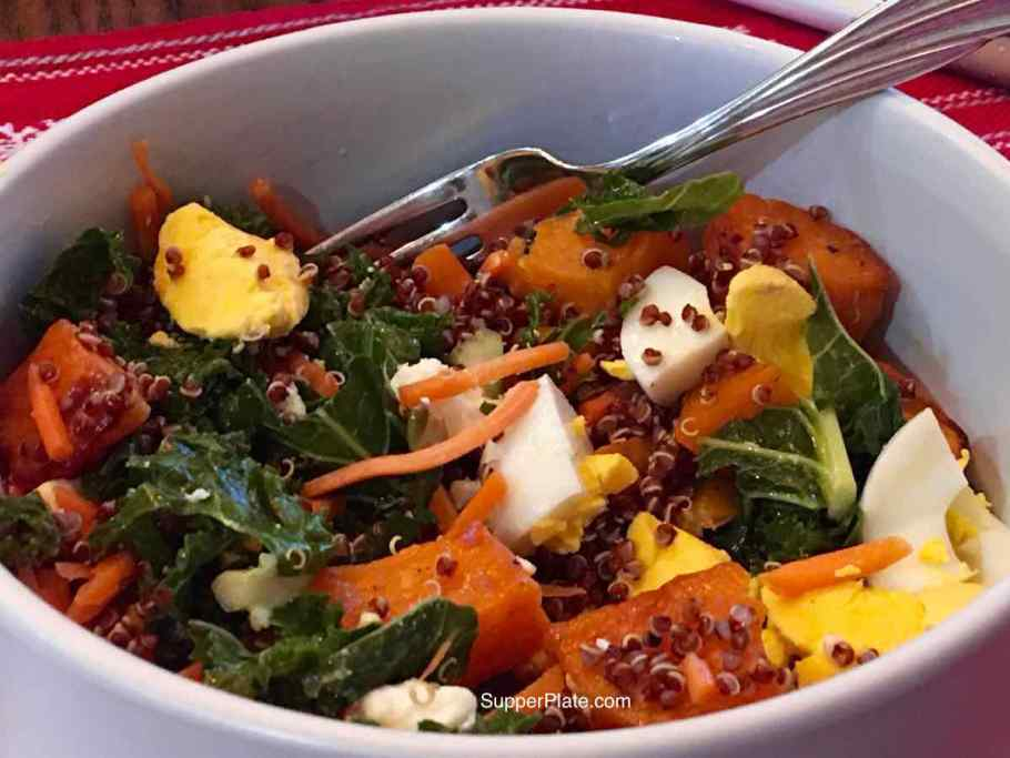 Kale Sweet Potato Salad in a white bowl with ingredients mixed together