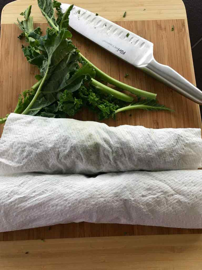 Rolling Kale in paper towels to dry