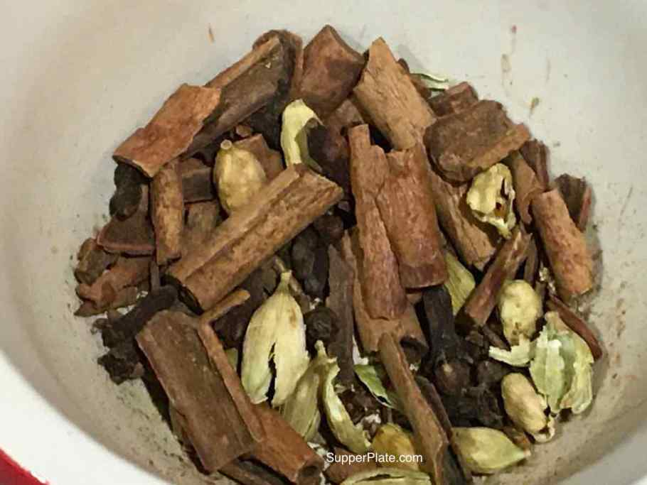 crushed spices in a mortar and pestle