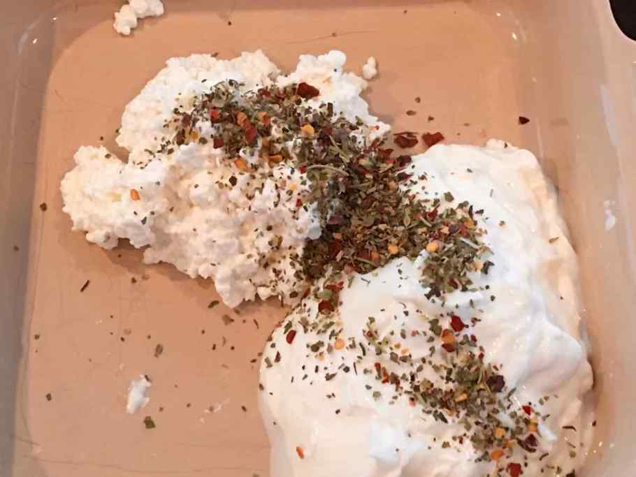 Cottage cheese and Greek Yogurt with spices in a baking pan
