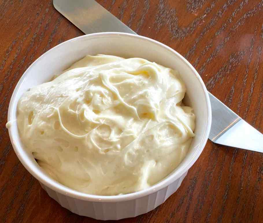 Cream cheese frosting in a white bowl