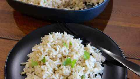 Plate of rice with a bowl of rice behind it