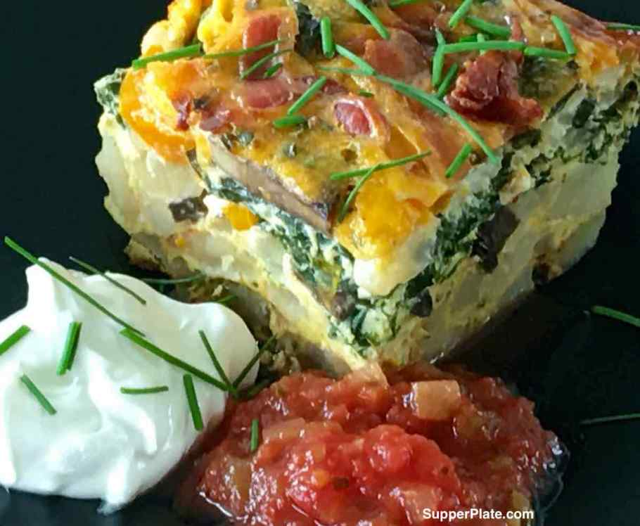 Breakfast Casserole with Bacon with salsa and sour cream on a plate