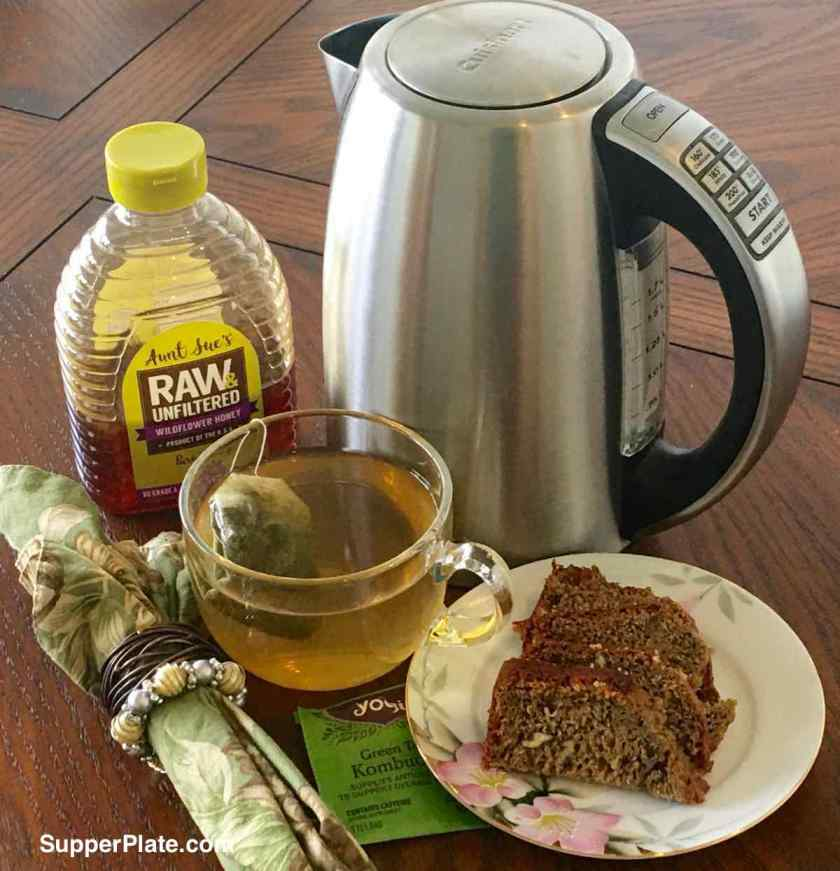 Cuisinart Electric Kettle Review with cup of tea raw honey and dessert bread