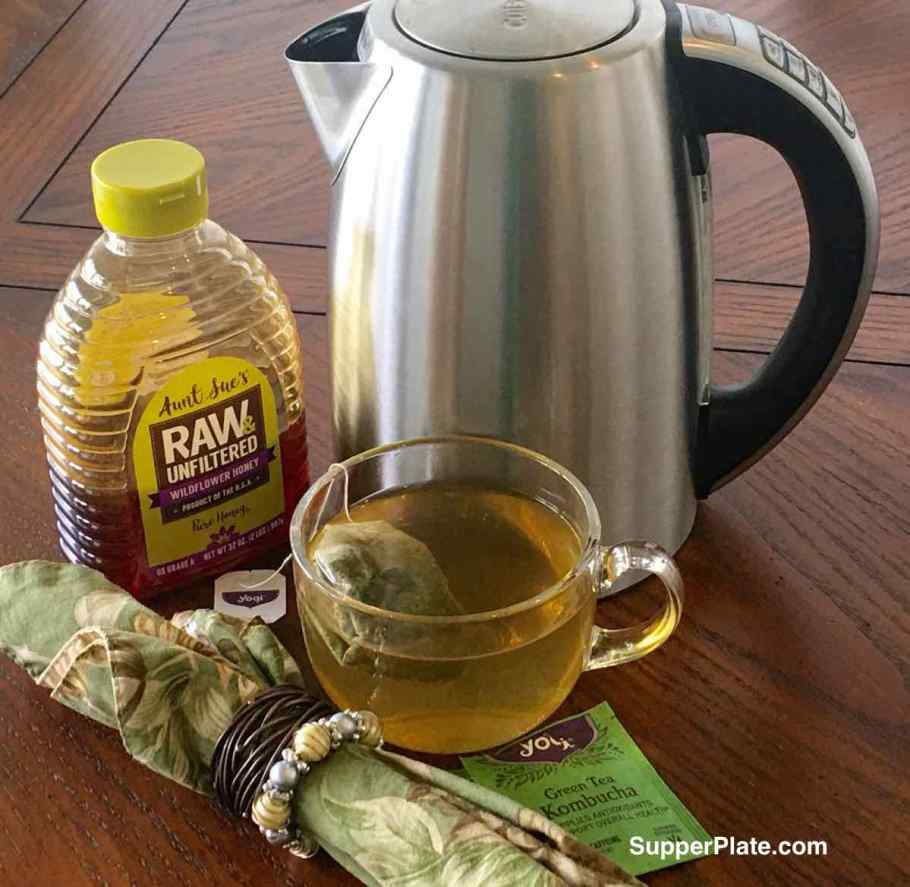 Cuisinart Electric Kettle Review with a cup of tea and bottle of raw honey