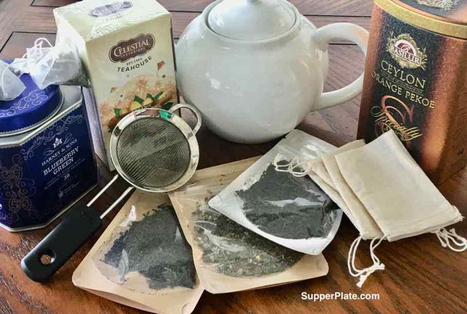 An assortment of tea in cans loose tea and tea pot