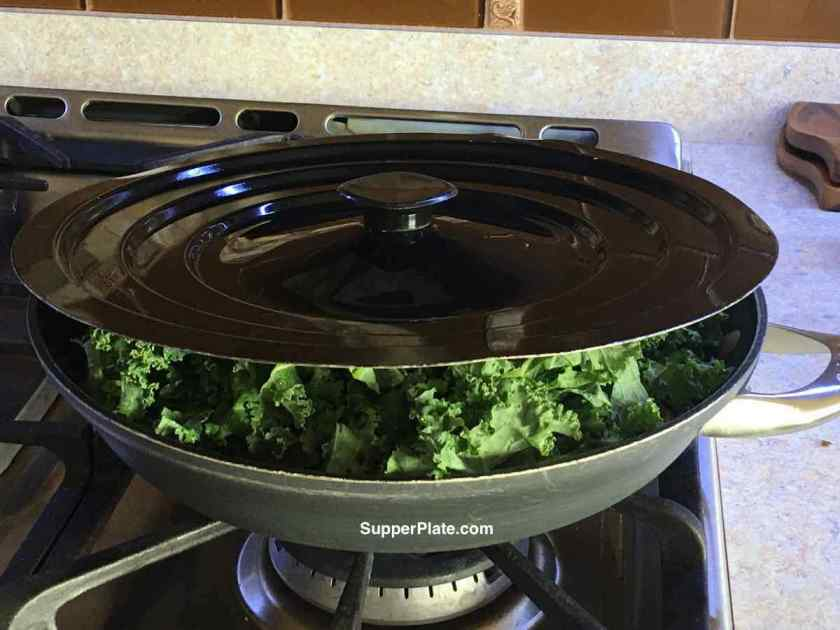 Kale in a frying pan with a lid