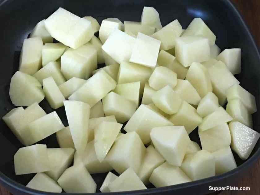diced potatoes in a black bowl
