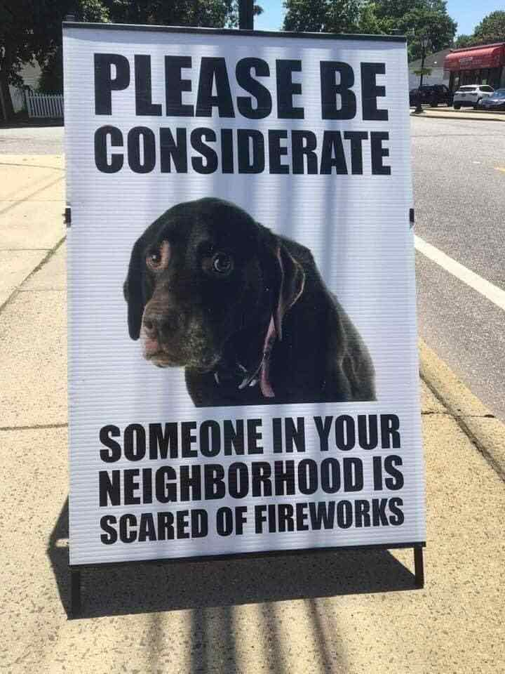 A sign with a dog on it saying please be considerate someone in your neighborhood is scared of fireworks