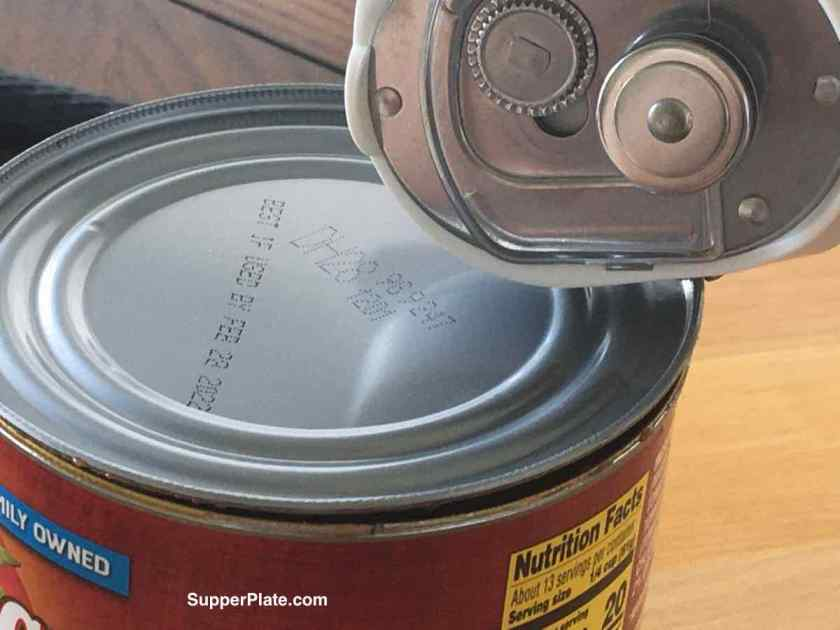 Opening a can with the smooth edge can opener