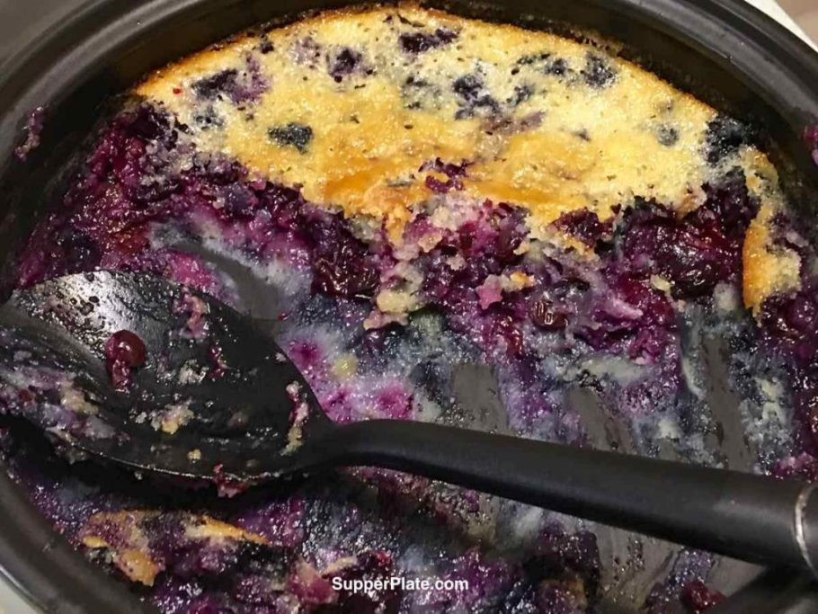 Rockcrok pan almost empty with a spoon and leftover blueberry cobbler