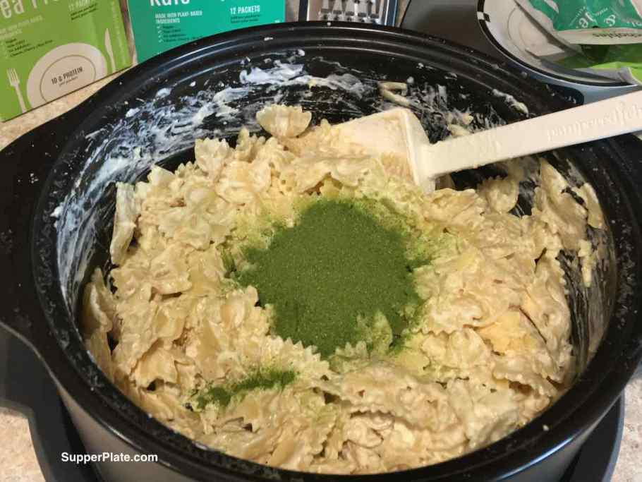Green powder in the center of pasta in a dutch oven
