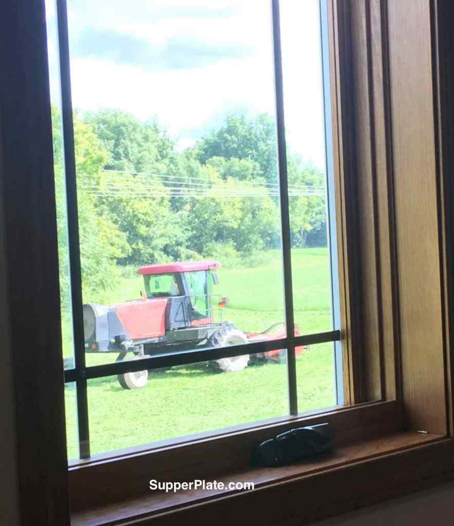 View of a tractor out of a window