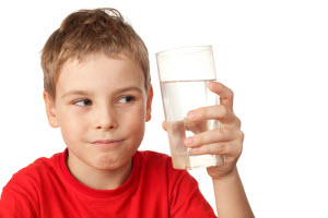 kid holding glass of water