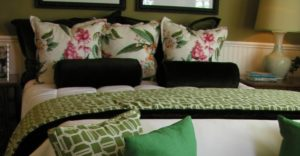 arranging pillows on a bed