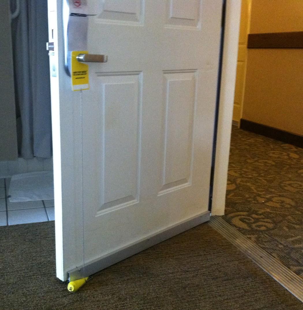 Sure Stop Wedge Used on Hotel Room Door & THE PATENTED SELF-ALIGNING DOOR STOP \u2013 SURE STOP WEDGE DOORSTOP