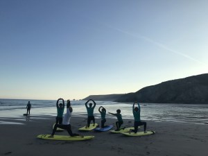 Yoga before the surf lesson